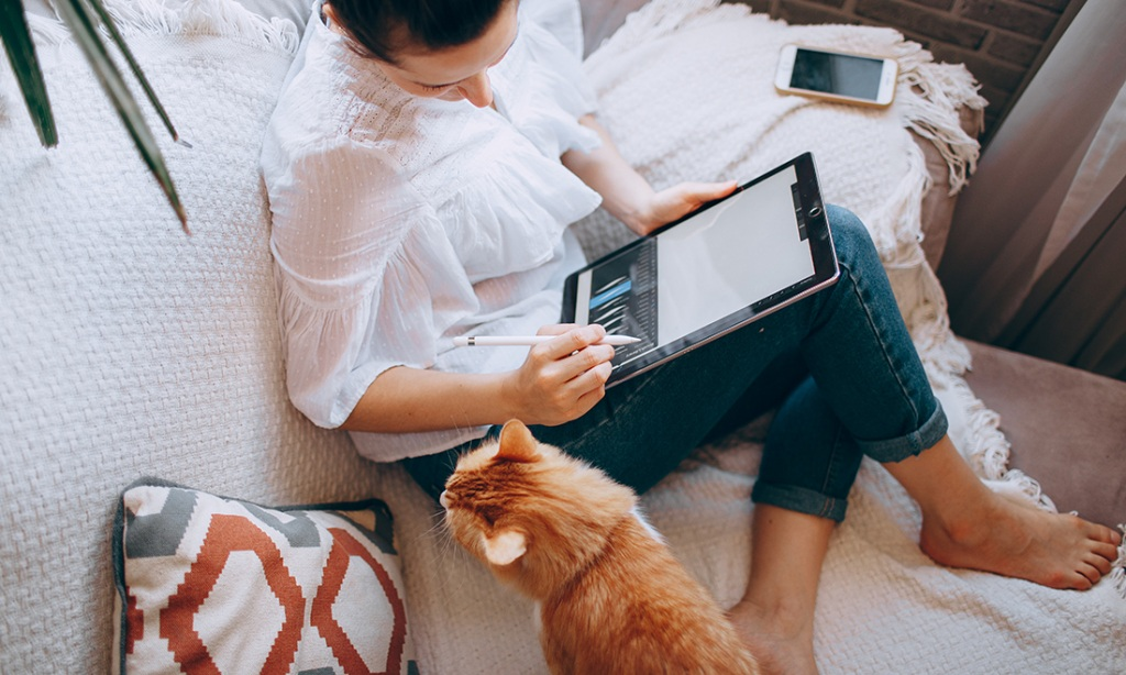 Girl and cat on sofa with heat pump repair